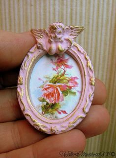 Miniature shabby oval frame with little angel