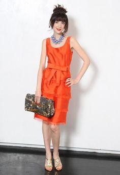 http://images.teamsugar.com/files/upl2/41/416654/24_2009/46a976988c75e477_kate_spade_orange_dress_2010.png