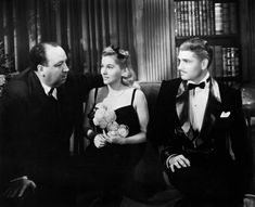 Joan Fontaine, Laurence Olivier and Alfred Hitchcock on the set of Rebecca (1940)
