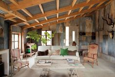 Farmhouse in France. Recovered corrugated iron from an old chicken coop dressing the walls and ceiling and untreated concrete flooring. AMAZING!
