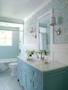 This bathroom features custom designed vanity in blue (Benjamin Moore Buxton Blue) with glass knobs, bubble tile accent wall and floor and wallpaper above wainscot. Bathroom Renos, Bathroom Interior, Small Bathroom, Bathroom Vanity Decor, Small Tub, Modern Bathroom Decor, Bathroom Designs, White Bathroom, Bathroom Ideas