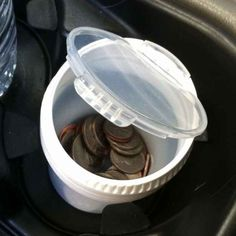Use an empty gum container to keep loose change not so loose. | 21 Insanely Clever Tricks To Vastly Improve Your Car
