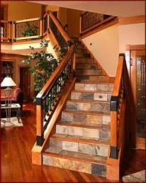 Love the slate/stone risers and platforms. I actually almost did this in my house. ...still might when the carpet needs to be replaced.