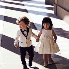 This adorable flower girl and ring boy! Tag your girls
