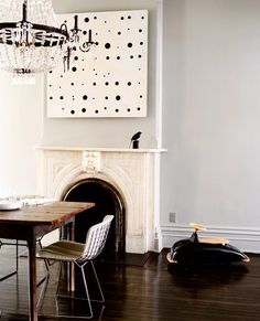 Suzie: Domino Magazine - Love the mix of vintage and modern in this space. Soft gray blue walls ...