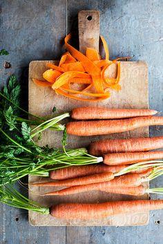 Preparing and Peeling Orange Carrots by SaraRemington | Stocksy United