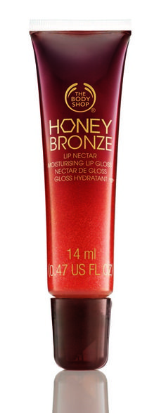 2. The Body Shop Honey Bronze Lip Nectar in Honey Bunch ($13)  This is one of those lip products that you can wear with a little mascara and call it a day. It's a peachy-colored gloss with iridescent sparkles, and looks lovely with sun-kissed skin.    http://www.glamour.com/beauty/blogs/girls-in-the-beauty-department/2012/07/three-lip-products-im-obsessed.html?mbid=nl_beautytips#