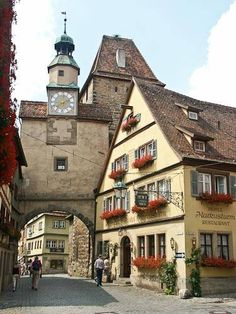 Rothenburg, Germany   We spent a lovely afternoon here visiting with friends while dining outside under a huge tree.