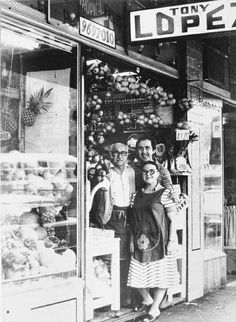 Antonio, Terzita and Tony Lopez in the doorway of the shop, 1960s.  In 1934 Antonio and Terzita Lopez opened a fruit and vegetable shop at...