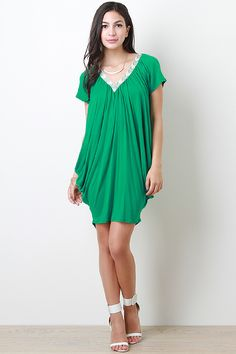 Are you looking for the perfect coverup to transition from the pool to the party? Try a dress like this one which is a quick comfortable coverup that will leave you looking simply chic. Best of all this dress is under $30!