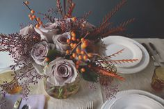 lilac, plum, and orange thanksgiving centerpiece