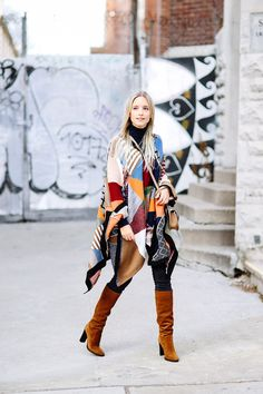 This fabulous poncho is a must-have for anyone wishing to try the patchwork trend! Charlotte Groeneveld rocks this statement Chloe piece, wearing it with gorgeous cowboy style boots and skinny denim jeans. Poncho/Bag: Chloe, Turtleneck: Zara, Jeans: 3X1, Boots: Jimmy Choo.