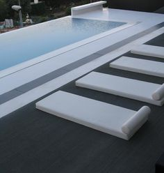 clean white spare pool and seating. what is better than that ? or what a great way to store your floats