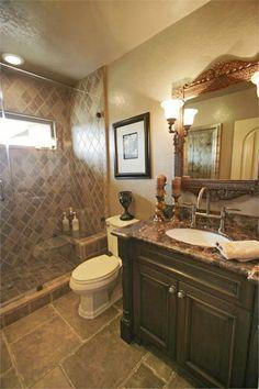 Master Bathroom Dark Cabinets crema marfil & dark emperador marble bathroom. | bathroom beauties