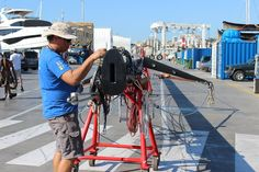 The procedure starts with both cranes lifting the rig horizontally before the main crane continues the lift and the smaller crane lowers and manoeuvres the butt until the mast is vertical. #SYAragon #RiggingInPalma