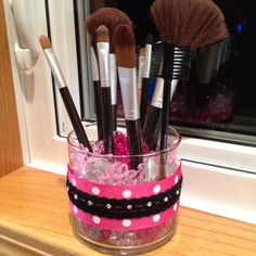 Make-up brush Holder *Reused an empty candle glass jar *Thick ribbon and thin ribbon glued together *pebbles found at Walmart by the fake flowers and vases