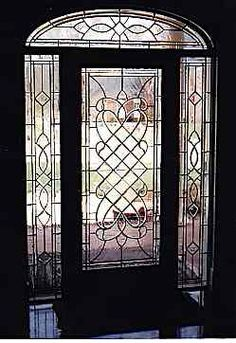 Glass & iron front door www.HomesOfLKN.com @Matty Chuah Lake Norman Group