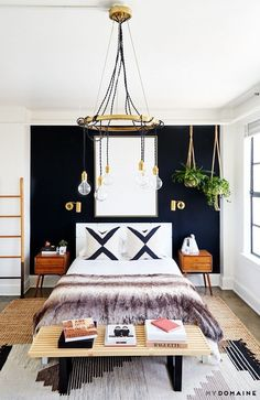 Bedroom with a dark wall in the downtown LA loft of Carlson Young and Isom Innis