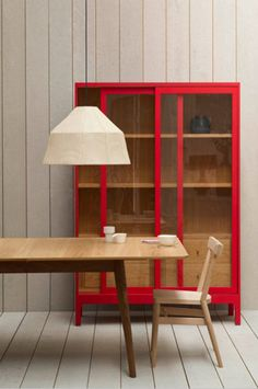 red trimmed shelf unit