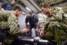 U.S. Navy Cmdr. Mark Haney, center, listens as U.S. Navy Petty Officers 2nd Class Daniel Clarke, left, and Daniel Soulliard, right, discuss the capabilities of the towfish side scan sonar system, Jan. 1, 2015. Haney is the executive officer assigned to the USS Fort Worth. Clarke and Soulliard are divers assigned to the Mobile Diving and Salvage Unit 1.hires_150101-N-YU572-127A.jpg (3000×2000)