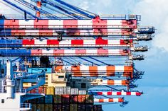 Peppermint-striped cranes load and unload cargo containers at Freeport Bahamas.  See more #photos at 75central.com