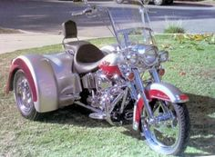 """2003 Harley-Davidson FLSTC/FLSTCI Heritage Softail Classic.   Red and Silver. Rigid mount, 1450cc Twin Cam 88B™ balanced engine with 5000 miles. 16"""" ape hangers with braided lines and hoses.  Converted to a Trike in 2012 with options: EZ-steer, Independent Suspension, Tortion Bar Upgrade, Chrome wheels and tires, Passenger hand-grips, carpeted trunk, trunk light, trunk mat w/logo, fender protectors, and a storage cover."""