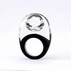 Zirconia Ring, Classic Clear and Black Resin with Large Zirconia Model: Zirconia Colour: Clear and Black This ring is of my own design and made entirely by me from the beginning. I start with embedding zirconia in the resin liquid. Then I cut, sand and polish it into a ring. All this long