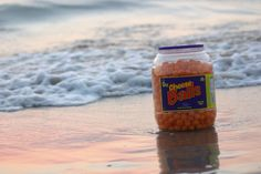 Eating cheese balls by the ocean