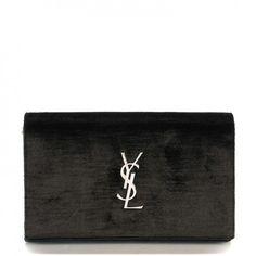 This is an authentic SAINT LAURENT Velvet Monogram Chain Wallet in Black. This stunning chain wallet is crafted of smooth, elegant velvet in a classic shade of black.