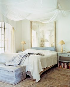 Yikes.  The mirror above the bed and the netting... all the white... love those things...