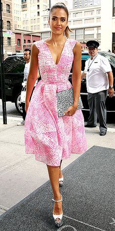 JESSICA ALBA | Where was this photo of Jessica when we needed inspiration for the gazillion summer weddings we went to? The patterned pink Antonio Berardi design could easily stand on its own (read: zero accessories needed), but the silver Brian Atwood peep-toes and printed envelope clutch only elevate the ensemble from a 10 to an 11.