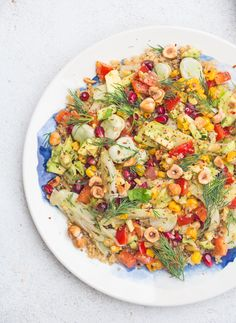 A simple, easy quinoa salad with avocado, marinated fennel, pepper, charred corn, broad bean pods, lemon juice, thyme, fresh dill, pomegranates and toasted pine nuts...