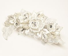 Hair Comes the Bride - Lace Flower Bridal Hair Piece - Dorothy, $68.00 (http://www.haircomesthebride.com/lace-flower-bridal-hair-piece-dorothy-1/)