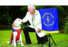 WAY FORWARD: Sunshine Coast Concert Band music director Ken Chadwick gets to know guide dog Archise ahead of the Musical Paws concert.