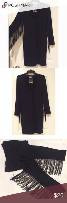 NWT. Under sleeve fringe v-neck dress CLOSED UNTIL AUGUST 15 ~NWT. Under sleeve fringe v-neck black dress. About 34 inch long. Long sleeve. The fringe is very thin string so the style is not too crazy and can be worn any time. Sorry, no trades. Like the item but not the price, feel free to make me a reasonable offer using the offer button below. DNY Dresses Long Sleeve