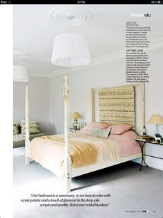 Walls in Great White (Farrow & Ball), with pink bed linen and a touch of green and caramel