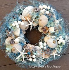 Hey, I found this really awesome Etsy listing at http://www.etsy.com/listing/176485246/striking-13-in-seashell-wreath-in-blue