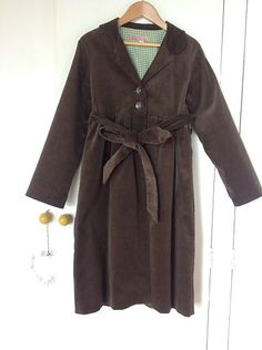 Brown cord coat with lovely green gingham lining. Could definitely do some Nancy Drew investigating in this!