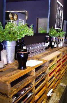 Wooden pallet shelves. From the photo, looks like it could store bottles of wine, and has cookie sheets to use as drawers?