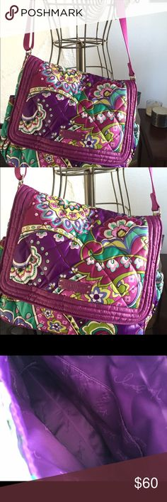 Vera Bradley purse Gorgeous vera Bradley purse.  15 x 12. In excellent condition. Has one pocket on each side. Full length zippered compartment On The back side of the purse. purple lining, along with two pockets inside, also two full pockets under flap on front of purse.  Adjustable padded shoulder strap. gently loved, if you have any questions please ask Bags Shoulder Bags