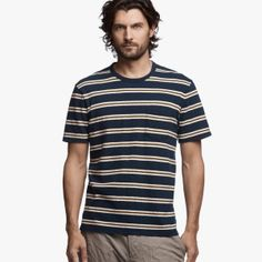 Retro stripe pocket tee. Bound crew neck in contrast color self fabric. Patch pocket on left chest. Short sleeves with single fold coverstitched hem. Single fold coverstitched straight bottom hem. RSJ makes this updated JP men's tee shirt an excellent layering piece for the Spring season. Novel striped pattern in classic colors for a vintage aesthetic.Additional Information:• 100% Cotton • Fabric: RSJ• Fabric from Japan • Length: 28 in. • Garment washed with ext...