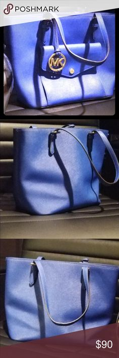 *NWOT* Michael Kors Purse Royal blue Michael kors purse. Used a couple times but it's been sitting in my closet majority of the time.   Send me an offer and let's negotiate :) Michael Kors Bags Shoulder Bags