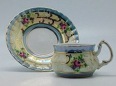 Victorian Mini Tea Set Gold Cup & Saucer Essence of Europe Gifts,http://www.amazon.com/dp/B009ZXCWTK/ref=cm_sw_r_pi_dp_-fkytb1MCC9H30ME