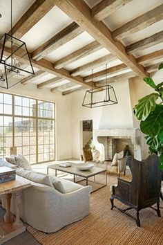 Contemporary Living Room with Pendant Light, Hardwood floors, Exposed beam, Cement fireplace