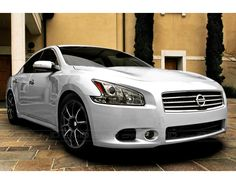 2012 Nissan Maxima - I love the pearl finish with the black roof and the lights that look like diamonds on the mirrors.  Dream car.
