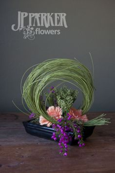 Contemporary arrangement of gerber daisies, minolino sticks, baronia heather and berzillia JP Parker Flowers