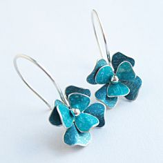 Double layer rosa drop earrings in turquoise blue by Penny Warren.   Aluminium and silver
