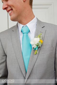 Love the Gray suit and turquoise tie next to the white and yellow boutonniere