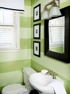 Green Bathroom. Love the striped paint with black accents. Makes the white pop!