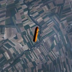 Picture of the day for December 10 2016 at 08:42PM from 'Daily Overview;  Check out this incredible overview of the external fuel tank from the Space Shuttle falling back towards Earth following a launch. At the moment this shot was taken the tank was flying over the textile-like fields of Northeastern France. /// Photography courtesy of @NASA